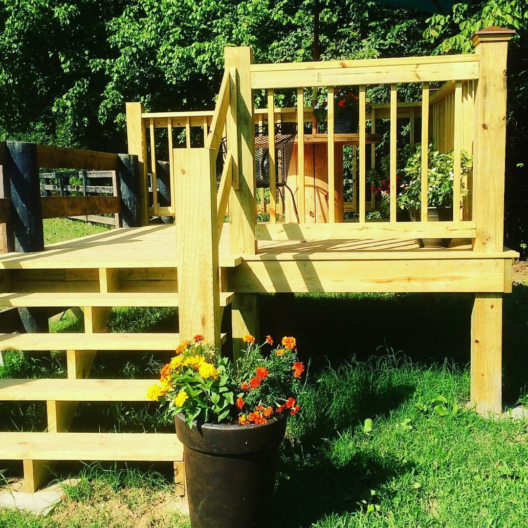 Newly built deck with colorful flowers