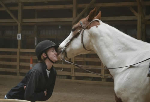 Razor Creek Stables Girl and Horse touching noses